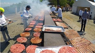 Huge Italian Street Food Festival of Grilled Meat. Ribs, Sausages, Chicken and More Meat