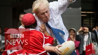 Boris Johnson takes out boy in rugby - BBC News