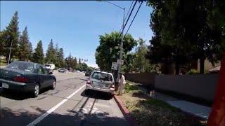 Rude lady blocks bike lane,  Police called.  5UNW292