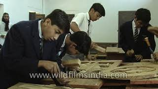 Scindia School students carve masterpieces of wood in wood work shop, circa 1992
