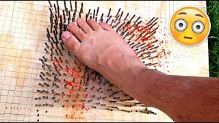 WALKING ON A BED OF NAILS CHALLENGE!!! (TERRIBLE IDEA)