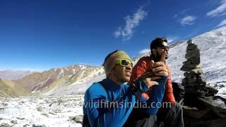 Arjun Vajpai shovelling snow at the Golep Kangri expedition