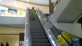 Mallu aunty climbing an escalator - Very funny