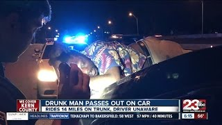 Man drives 14 miles on the interstate with a drunk guy sleeping on top of his car without realizing