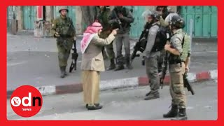 Elderly Palestinian man confronts armed Israeli soldiers before collapsing