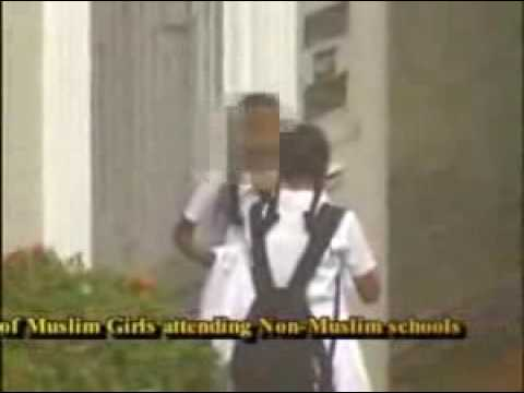 Young Muslim Girls Forced To Remove Clothes In The Street...... By JHU Buddhist Monks And Sri ankan Sinhala 'Only' Government ..wmv