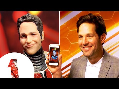 Paul Rudd on his RIDICULOUS Ant Man action figure.
