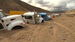 California mudslide cleanup starts slow