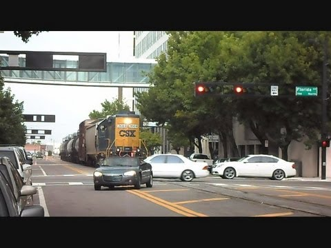CSX Train Gets Cut Off By Cars In Middle Of City Street