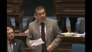 Minister Cliff Cullen answers a question on mining in the Legislature