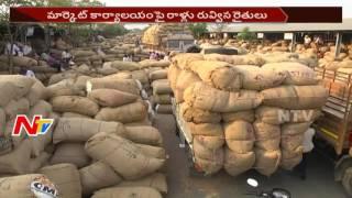 ఖమ్మం మిర్చి మార్కెట్లో రైతుల ఆందోళన || కాంటాలను ధ్వంసం చేసి తగలబెట్టిన రైతులు || NTV