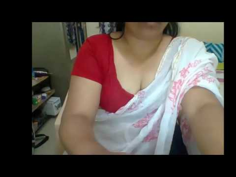 Indian desi  aunty wearing red and white saree