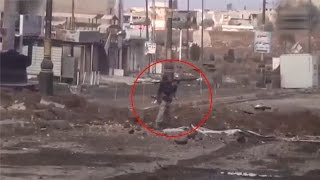 ISIS terrorist with the grenade launcher has been struck by sniper's shot [Mosul,Iraq]