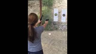Hot girl fires two guns