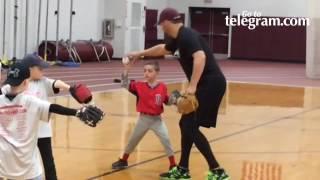 Rick Asadoorian teaches kids fundamentals of baseball
