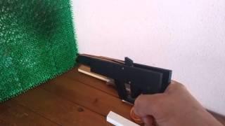 Laser cut rubber band gun
