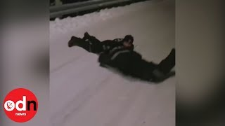 Having a RIOT! Norwegian police use riot shields for sled races!