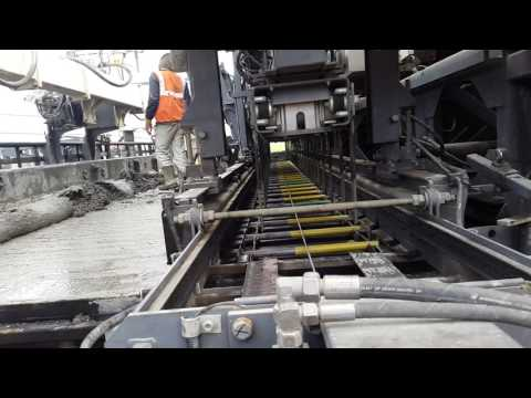 Laying Concrete Pavement (PQC ) on NH-64