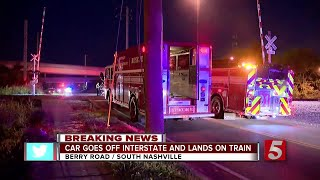 Car Goes Off Interstate, Lands On Train