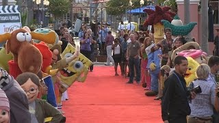 Universal Orlando characters greet attendees on the red carpet at private party
