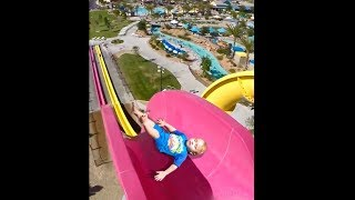 kid falls off tall water slide...