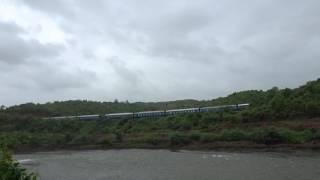 Train video taken near flowing Patalganga river. Heavy windy Monsoon season