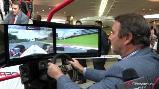 Nigel Mansell playing F1 racing video game