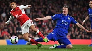 Arsenal beat Leicester through Huth