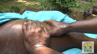 Marq James an athletic massage in an outdoor setting