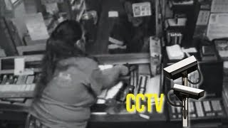 World's most stupid criminals - Brave shopkeeper shows no fear as a hoodlum pulls a gun on her