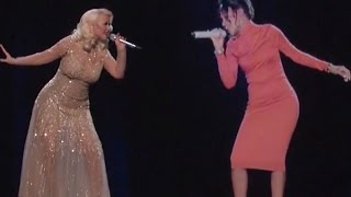 Christina Aguilera gets caught singing with the ghost of Whitney Houston