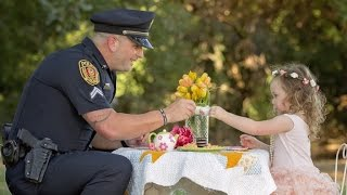 Police Officer Has Adorable Tea Party with Little Girl He Saved From Choking