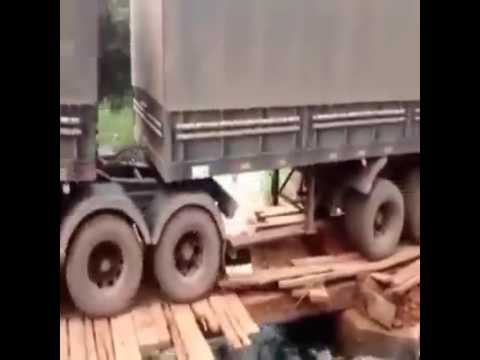 Xxx Mp4 12yo Girl Driving A Huge Fully Loaded Semi Over A River With A Half Broken Bridge 3gp Sex