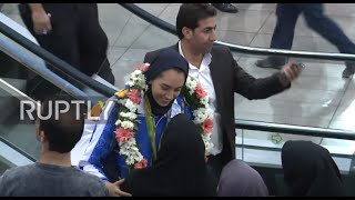 Iran: Country's first female Olympic medal winner given hero's welcome in Tehran