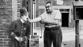 """شاهد فيلم العصابات الكوميدي شارلي شابلن """"الشارع السهل"""" Easy Street 1917 كامل ومترجم"""