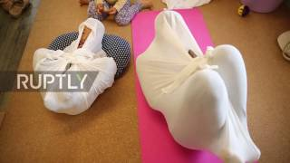 Japan: 'Adult wrapping' therapy promises to vanish aches and pains in Tokyo