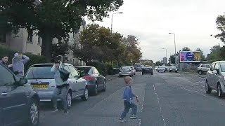 Close Call - Kid runs out in front of car.