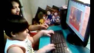 computer prodigy roopkotha playing super mario. his mum cynthia farheen risha besides him
