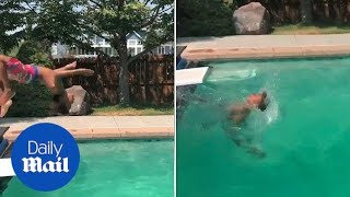 Little boy faceplants diving board while backflipping into pool - Daily Mail