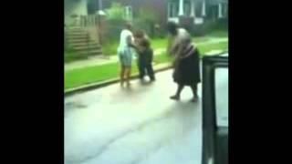 Two fat women fighting on the street