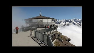 News Hundreds rescued by helicopter after cable car breaks down on Swiss mountain featured in a J...