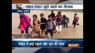 Madhya Pradesh: Children take risk to cross flooded river to reach school