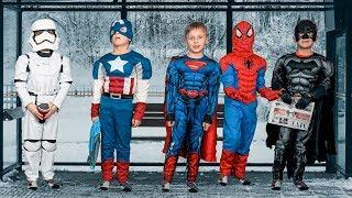 Superheroes at the Bus Stop: Spiderman, Batman, Superman and Captain America