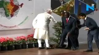 Mugabe stumbles onto stage in India