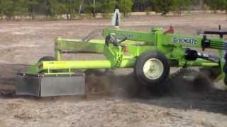 Easy way to pickup roots, stumps and chunks with a Schulte SRW1400 Windrower & RS320 Rock Picker
