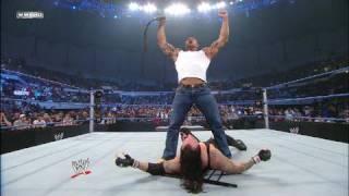 Batista attacks World Heavyweight Champion Undertaker
