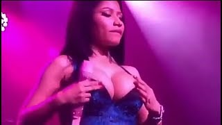 Nicki Minaj Grabs Her Boobs As She Feels Herself Up While Wearing A See-Through Dress