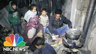 Families Shelter Underground As Syria Cease-Fire Fails To End Fighting | NBC News