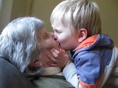 Cute kid can't stop kissing his Granny
