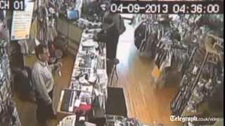CCTV captures shot shop owner scaring off gunman